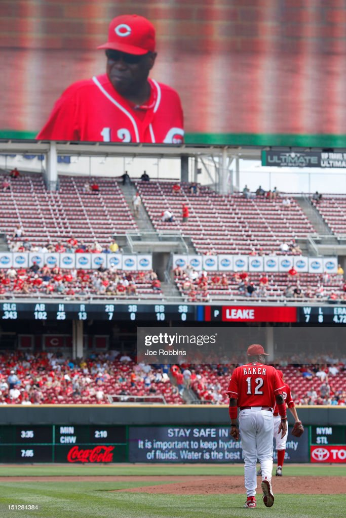 Cincinnati Reds manager Dusty Baker makes his way to the mound during the game against the Philadelphia Phillies at Great American Ball Park on September 5, 2012 in Cincinnati, Ohio. The Phillies won 6-2.