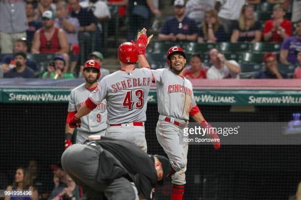 Cincinnati Reds outfielder Scott Schebler is congratulated by Cincinnati Reds center fielder Billy Hamilton after hitting a 2run home run during the...