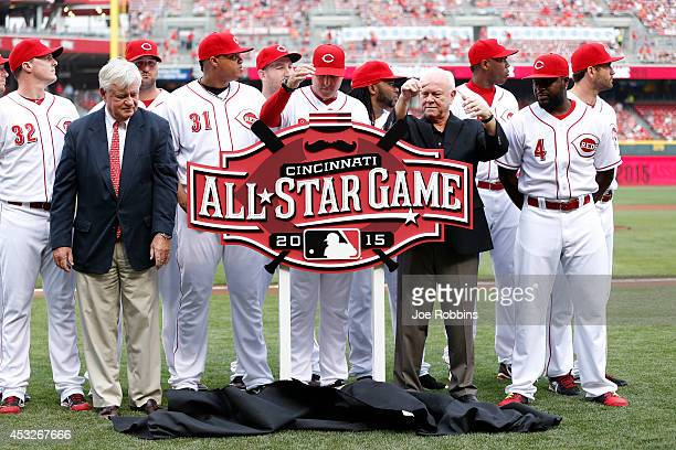 Cincinnati Reds owner Bob Castellini and general manager Walt Jocketty unveil the 2015 All Star Game logo prior to the game against the Cleveland...