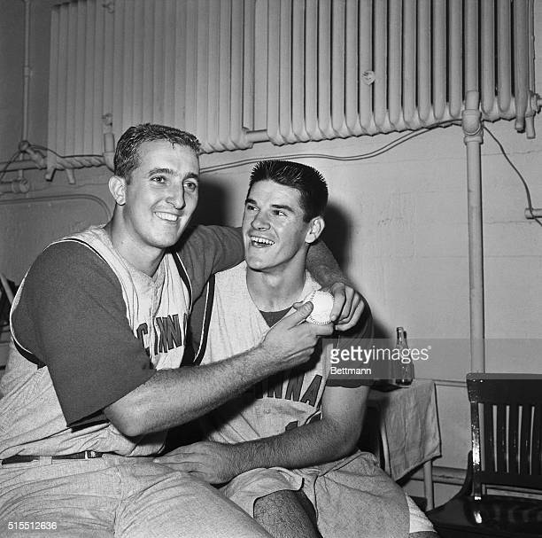 Cincinnati Reds pitcher Jim Maloney and teammate Pete Rose celebrate in the dressing room after winning the second game and splitting a doubleheader...