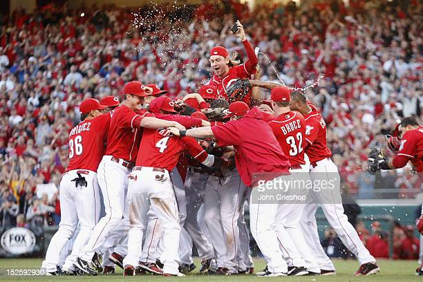 Cincinnati Reds players celebrate a National League Central Division Championship during the game against the Los Angeles Dodgers at Great American...