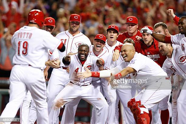 Cincinnati Reds players celebrate after Joey Votto's gamewinning home run in the bottom of the ninth inning of the game against the Colorado Rockies...