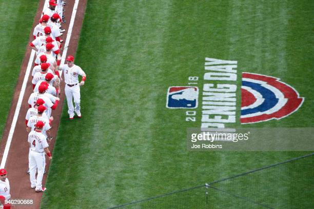 Cincinnati Reds players take the field prior to Opening Day against the Washington Nationals at Great American Ball Park on March 30 2018 in...