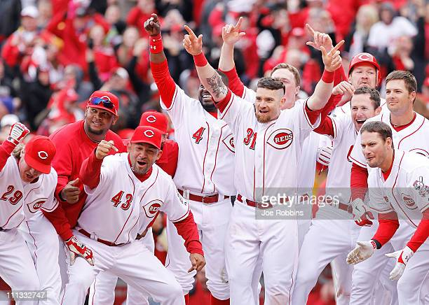 Cincinnati Reds players wait at home plate for Ramon Hernandez after his gamewinning home run in the ninth inning against the Milwaukee Brewers in...