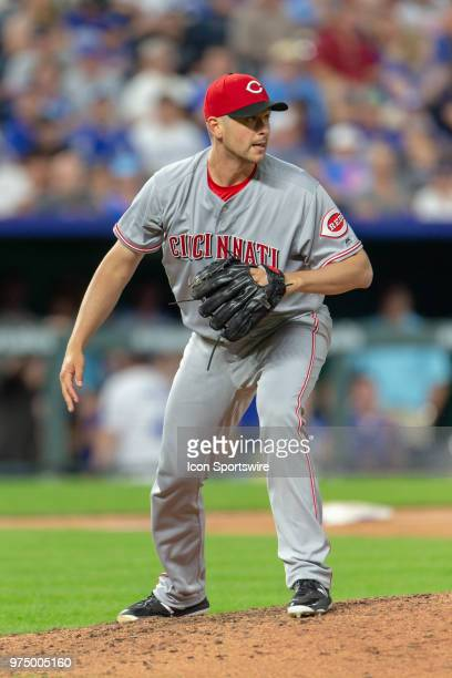 Cincinnati Reds relief pitcher Jared Hughes looks to first base during the MLB interleague game against the Kansas City Royals on June 13 2018 at...