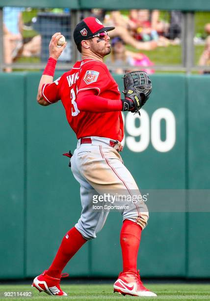 Cincinnati Reds right fielder Jesse Winker throws the ball to second base during the MLB Spring Training baseball game between the Cincinnati Reds...