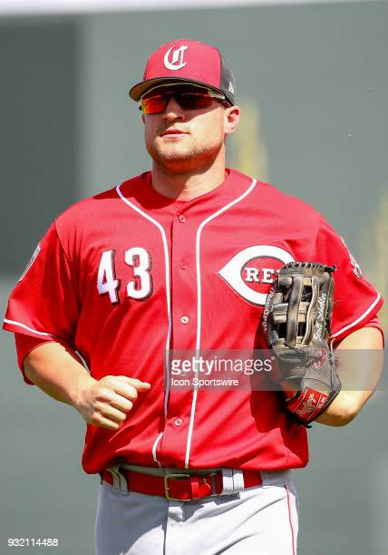 Cincinnati Reds right fielder Scott Schebler runs to the dugout during the MLB Spring Training baseball game between the Cincinnati Reds and the...