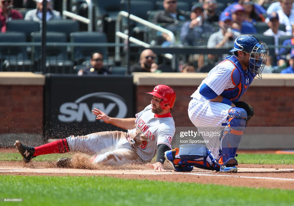 Cincinnati Reds Second Baseman Jose Peraza (9) scores on and RBI single by Cincinnati Reds Shortstop Zack Cozart (2) during the first inning of the Major League Baseball game between the Cincinnati Reds and the New York Mets on September 10, 2017 at Citi Field in Flushing, NY.