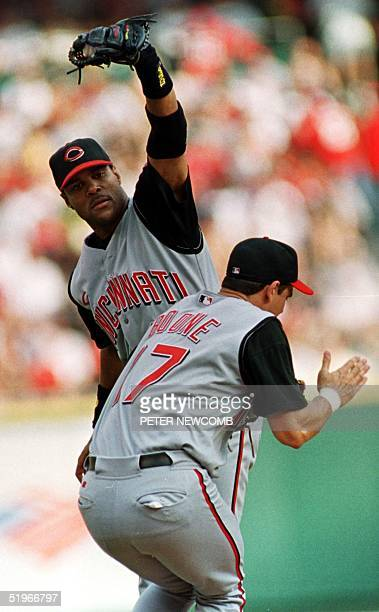 Cincinnati Reds Shortstop Barry Larkin catches a pop fly as third baseman Aaron Boone tries to avoid a collision in the second inning against the St...