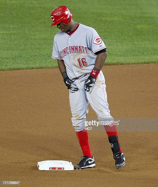 Cincinnati Reds shortstop Edgar Renteria limps into second base after getting a hit agains the Washington Nationals during the seventh inning at...