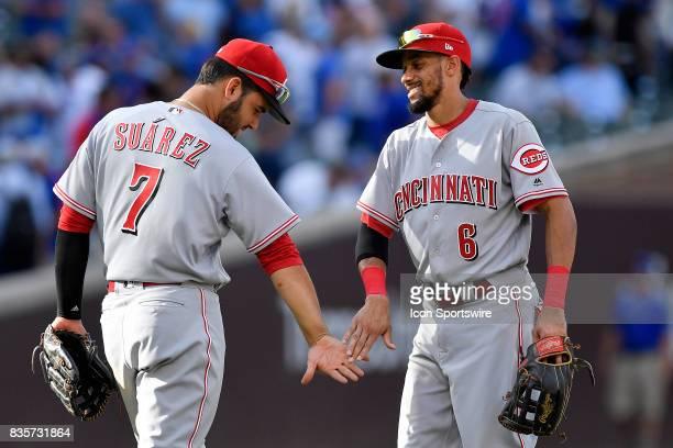 Cincinnati Reds third baseman Eugenio Suarez and Cincinnati Reds center fielder Billy Hamilton celebrate after winning against the Chicago Cubs on...