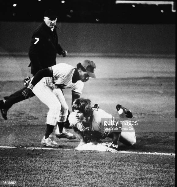 Cincinnati Reds third baseman slides head-first into third base, safely ahead of the tag by the New Yoprk Mets' Lenny Randle in the first inning of a...