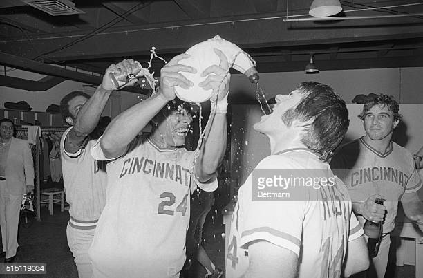 Cincinnati Reds' Tony Perez gets an unexpected dousing while helping teammate Pete Rose celebrate the Reds' 4-3 victory over the Astros 9/22 in...