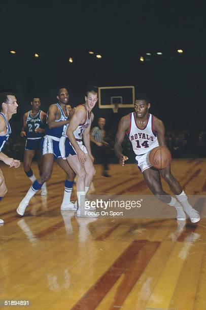 Cincinnati Royals' Oscar Robertson dribbles to the net against the Los Angeles Lakers at the Cincinnati Gardens in Cincinnati Ohio