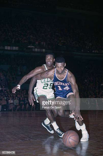 Cincinnati Royals's Oscar Robertson dribbles downcourt against the Boston Celtics during a game in 1964 at the Boston Garden in Boston Massachusetts