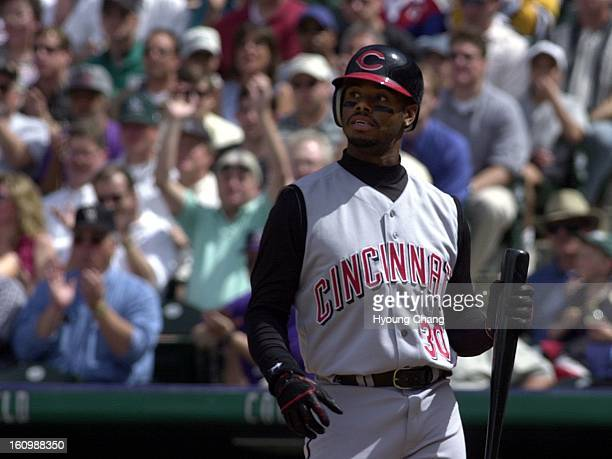 Cincinnati's Ken Griffey Jr leaves batter box after his swinging out by Colorado's Masato Yshii in the 3rd inning at Coors Field on Wednesday Rockies...