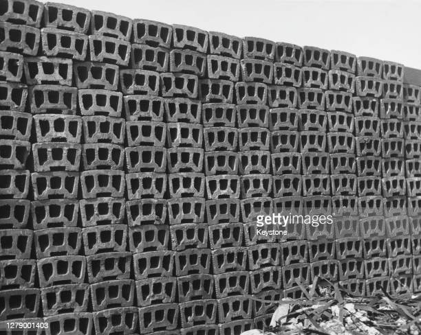 Cinder blocks stacked up on a construction site, circa 1955. Cinder blocks are so-called due to them containing cinders as an aggregate material.