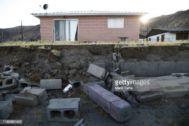 Cinderblocks from a toppled wall are scattered outside the Eldridge family home which has been deemed uninhabitable due to structural damage from the...