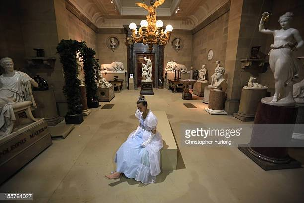 Cinderella alias Chatsworth staff member Rosie Hodgkinson poses in the sculpture gallery of Chatsworth as the stately home's pantomine themed...