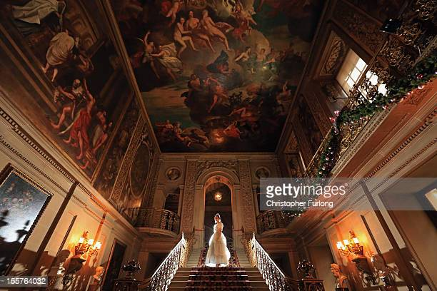 Cinderella alias Chatsworth staff member Rosie Hodgkinson poses in the painted hall of Chatsworth as the stately home's pantomine themed Christmas...