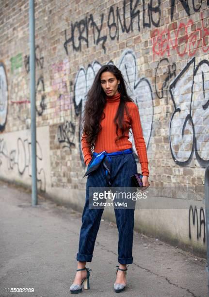 Cinderella Balthaza is seen wearing turtleneck, navy striped pants outside Belstaff during London Fashion Week Men's June 2019 on June 09, 2019 in...