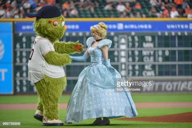'Cinderella' is congratulated by 'Orbit' after throwing out the first pitch during 'Princess Day' before the baseball game between the Detroit Tigers...