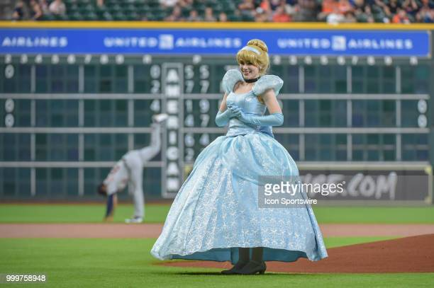 'Cinderella' throws out the first pitch during 'Princess Day' before the baseball game between the Detroit Tigers and the Houston Astros on July 15...