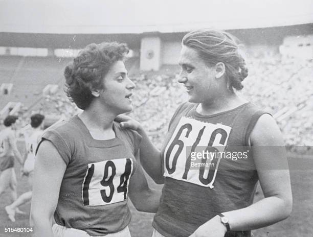 Cinderellas Moscow USSR Athletic sisters who are queens of the track world Irina and Tamara Press congratulate each other after both scored world...