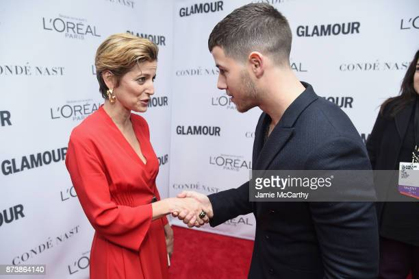 Cindi Leive and Nick Jonas attend Glamour's 2017 Women of The Year Awards at Kings Theatre on November 13 2017 in Brooklyn New York