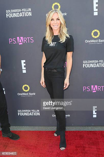 Cindy Ambuehl arrives at the PS ARTS' Express Yourself 2016 at Barker Hangar on November 13 2016 in Santa Monica California