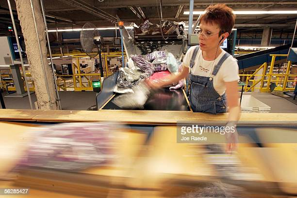 Cindy Amsden places clothing orders on a conveyor belt in the LL Bean shipping center on 'Cyber Monday' the online retail world's version of Black...