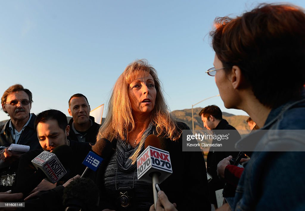Cindy Bachman, public information officer for the San Bernardino Sheriff's Department, updates the media at checkpoint manned by Redlands police during a manhunt for the former Los Angeles Police Department officer Christopher Dorner, who is suspected of triple murder, on February 12, 2013 in Yucaipa, California. Dorner barricaded himself in a cabin near Big Bear, California and is in a standoff with authorities after shooting two police officers, killing one and wounding the other. Dorner, a former Los Angeles Police Department officer and Navy Reserve veteran, is wanted in connection with the deaths of an Irvine couple and a Riverside police officer.