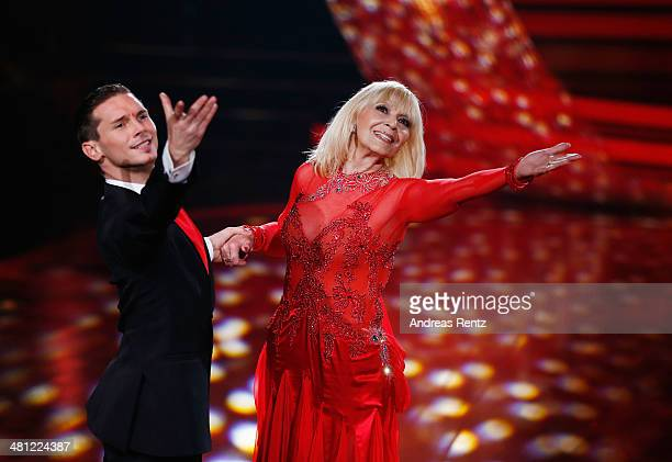 Cindy Berger and Marius Iepure perform on stage during the 1st Show of 'Let's Dance' on RTL at Coloneum on March 28 2014 in Cologne Germany