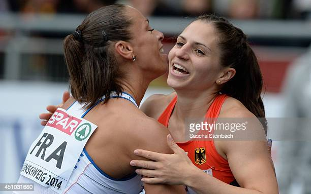 Cindy Billaud of France and Nadine Hildebrand of Germany celebrate after zthe Women's 100m Hurdles during second day of the European Athletics Team...