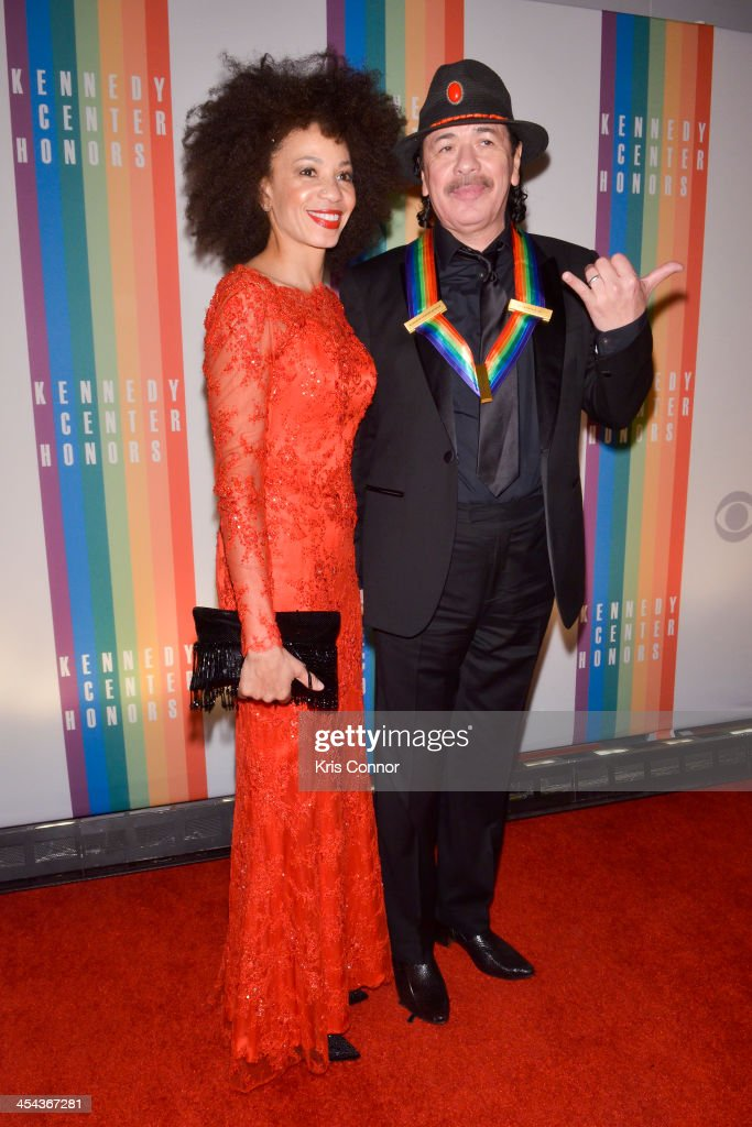 Cindy Blackman and Carlos Santana pose on the red carpet during the The 36th Kennedy Center Honors gala at the Kennedy Center on December 8, 2013 in Washington, DC.