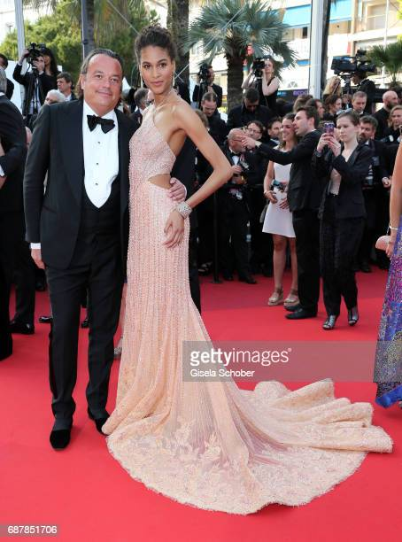 Cindy Bruna and a guest attend The Beguiled premiere during the 70th annual Cannes Film Festival at Palais des Festivals on May 24 2017 in Cannes...