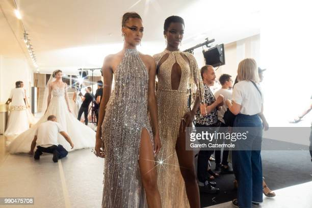 Cindy Bruna and Maria Borges backstage before the Georges Hobeika Haute Couture Fall Winter 2018/2019 show as part of Paris Fashion Week on July 2...