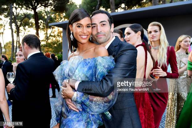 Cindy Bruna and Mohammed Al Turki attend the amfAR Cannes Gala 2019 at Hotel du CapEdenRoc on May 23 2019 in Cap d'Antibes France