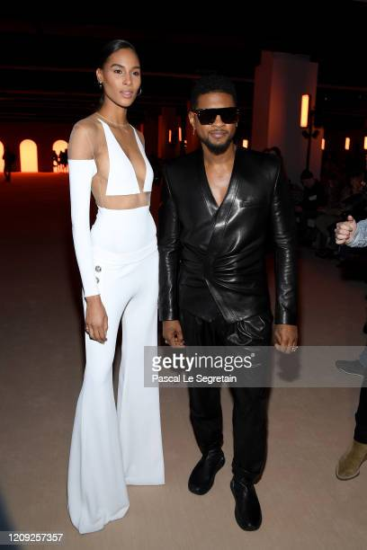 Cindy Bruna and Usher attend the Balmain show as part of the Paris Fashion Week Womenswear Fall/Winter 2020/2021 on February 28 2020 in Paris France