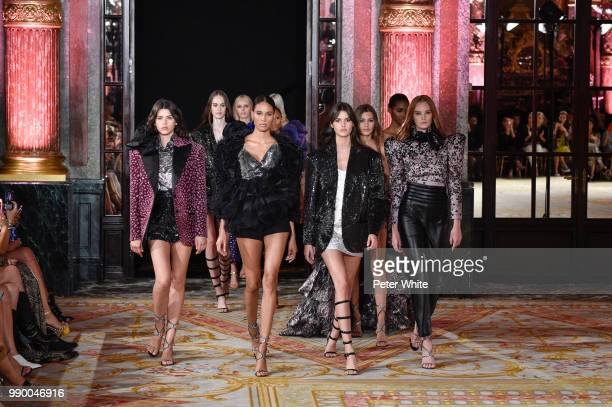 Cindy Bruna and Vanessa Moody walk the runway during the Redemption Haute Couture Fall Winter 2018/2019 show as part of Paris Fashion Week on July 2,...