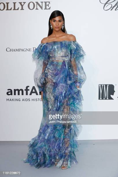 Cindy Bruna attends the amfAR Cannes Gala 2019 at Hotel du CapEdenRoc on May 23 2019 in Cap d'Antibes France