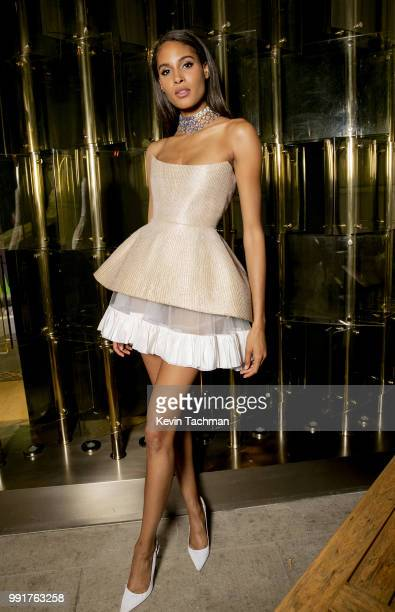 Cindy Bruna attends the amfAR Paris Dinner at The Peninsula Hotel on July 4 2018 in Paris France