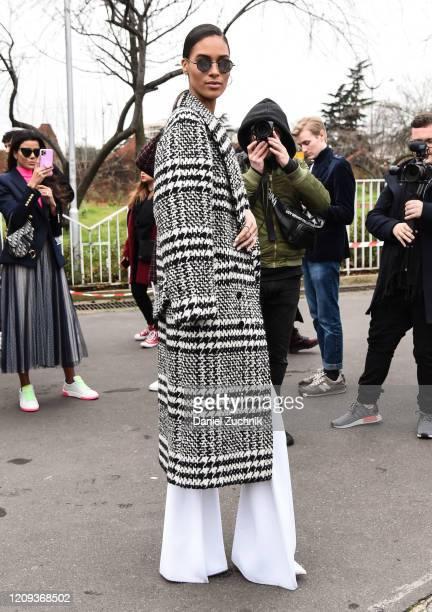 Cindy Bruna is seen wearing a Balmain plaid coat outside the Balmain show during Paris Fashion Week: AW20 on February 28, 2020 in Paris, France.