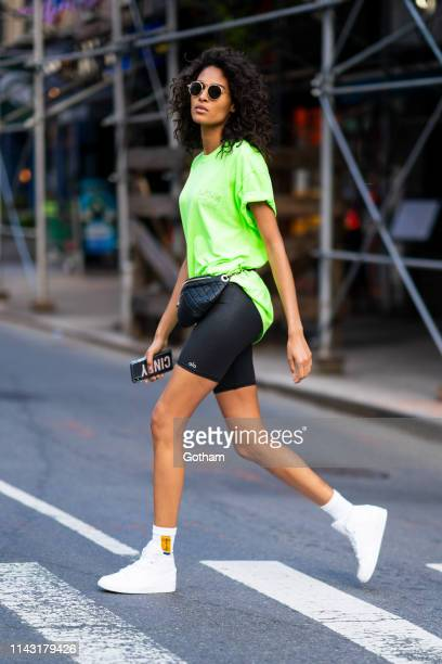 Cindy Bruna is seen wearing a Livin Cool shirt Alo Yoga shorts Chanel fannypack Pyer Moss socks and Nike sneakers in Murray Hill on April 16 2019 in...