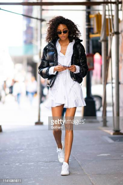 Cindy Bruna is seen wearing a Moncler jacket and Almaz dress with a Balenciaga handbag in SoHo on April 07 2019 in New York City