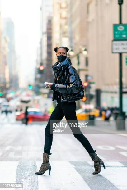 Cindy Bruna is seen wearing a Moncler jacket, YProject bodysuit and Fendi shoes in Midtown on January 21, 2021 in New York City.