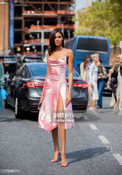 Cindy Bruna is seen wearing pink silk dress during New York Fashion Week September 2019 on September 09, 2019 in New York City.