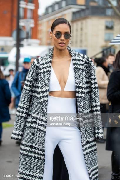 Cindy Bruna is seen wearing white pants top coat outside Balmain during Paris Fashion Week Womenswear Fall/Winter 2020/2021 Day Five on February 28...