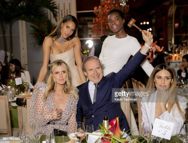 Cindy Bruna Maria Borges Nicky Hilton Simon de Pury and guest attend the amfAR Paris Dinner at The Peninsula Hotel on July 4 2018 in Paris France