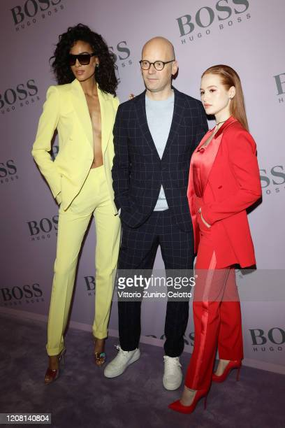 Cindy Bruna Mark Langer and Madelaine Petsch attend the BOSS fashion show during the Milan Fashion Week Fall/Winter 2020 2021 on February 23 2020 in...